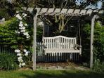 Rose arbor with teak swing