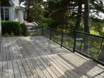 Back deck with 9th hole golf course views, patio chairs and a gas BBQ.