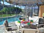 Extended pool deck with removable safety fence