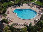 Heated pool adjacent to beach and Gulf of Mexico.