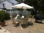 1st Floor sunny patio, table, lounge chairs, gas grill