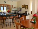 Fully equipped kitchen with tropical garden view and Carribean view