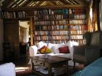 Books and comfy sofas with the wood burning stove.