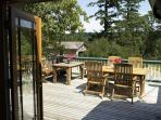 Outdoor seating for 10+ on the 400 square foot deck with gorgeous water views to the east and south.
