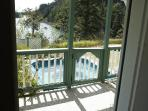 Large hot tub is conveniently right off the front porch, with unobstructed 180 degree water view.