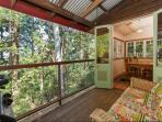 Cottage verandah looks out to the forest