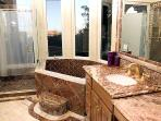marble appointed bathroom