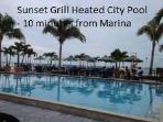 Swim at the city heated pool at Sunset Grill less than 10 minutes from the home