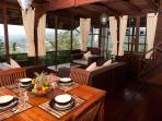 Large sitting/dining room with stunning views of lake Beratan & Bedugul valley
