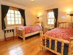 Another upstairs bedroom with two comfy twin beds