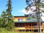 Set in the woods with a view of Lake Superior from the covered deck & every room that faces the lake
