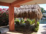 Relax under the Chiki Hut by the water