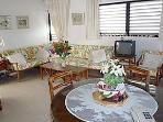 livingroom/diningroom - living room has 2 corner convertible sofas which make into 2 single beds