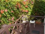 corner back balcony with sitting area, great for an early morning coffee watching the hummingbirds