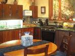Dining Room / Kitchen area with expandable table that accommodates up to 8 people