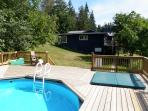 View from pool & hot tub deck towards the house.