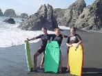 The \'Boogie Board Girls\' on Poppy Seed beach below the \'Landship\' ..... part of our crew !