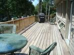 deck with table and grill