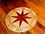 Custom hardwood inlayed compass.