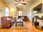 Classic beach cottage décor, ceiling fan, seating for 6 people and flat screen TV with stereo system.