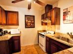 Kitchen is newly remodeled with granite counters and ceramic tiled flooring