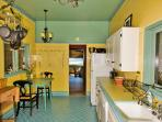 Charming kitchen is fully equipped and has a breakfast table for two.
