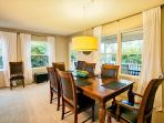 Lots of windows compliment the dining area.