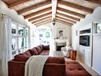 Classic high beamed ceilings and a huge couch for relaxing in front of the flat screen TV. Fireplace is nice for chilly...