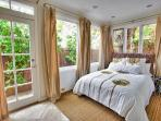Master bedroom is soothing and comfortable with a king size bed.