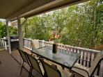 Outdoor deck with gas BBQ and seating for 5 guests.
