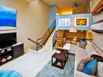Living room is on second level, master is up the stairs, kitchen one level below and 2 other bedrooms on lower floor.