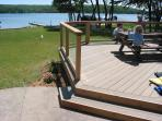 View from north side of house, of the deck and lake