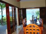 Dinning/Living room - becomes open-air with fans...Lake and garden, spectacular views, pool below