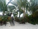Steps from garden to sandy beach