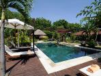 Swimming pool with sunbeds and a Gazebo for relaxing