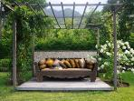 Big relaxing couch in the tropical garden