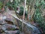 Stone stairway from driveway to main house