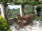 Alfresco dining with a view down the valley to the Adriatic Sea
