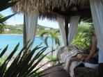enjoy a relaxing massage in the only oceanfront bali hut on st john