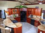 Well stocked granite & mahogany gourmet kitchen w/ GE Profile appliances