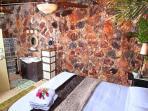 bedroom native stone wall