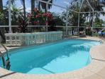 Private pool enclosed within the screened in lanai for bug-free swimming and sunning
