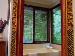 The master bedroom en-suite has views onto walls of bamboo.