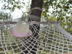 Relax on one of the hammocks in the large garden at La Scuola Holiday Home!