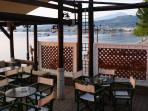 Seaside coffe-bar in Longos in the morning, 400 m from Harmony