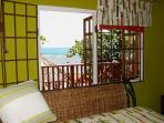 Air conditioned bedroom with queen size bed and direct access to deck