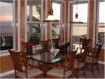 Dining Area with direct ocean view and a table for 8, with seating for 2 at the counter