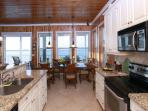 The Kitchen at Abaco Palms - features granite countertops and stainless steel appliances.