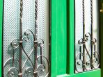 110-year old hand-made iron grids on entrance door