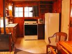 There's a fully-equipped kitchen with refrigerator, microware & stove with oven.